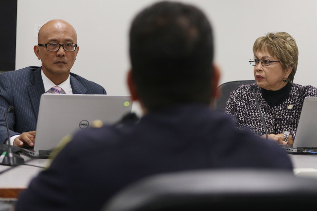 Vice Chair Will Espero and committee member Lorraine Inouye question HPD Major Andrew Lum about possible body cameras.