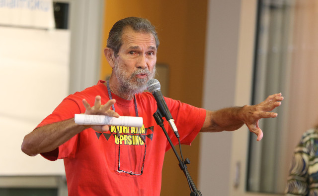 Molokai resident Walter Ritte speaks at start of gathering Windward Community College