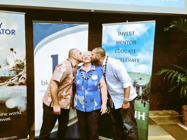 The brothers behind Sultan Ventures, Omar, left, and Tarik, right, plant a kiss on their mom, Aida Sultan, at a 2015 startup conference in Honolulu.
