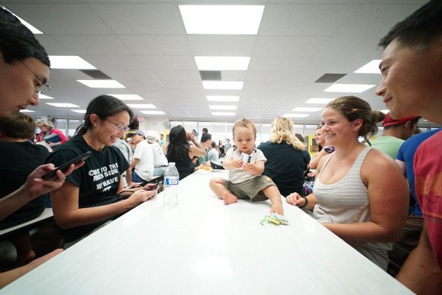 10-month old Altas Tang with mom, Ingrid Weisse and right, dad Ronald Tang, as he enjoys sitting on the cafeteria table at Manoa Elementary School. Democratic Party District 23 Manoa. 26 march 2016.