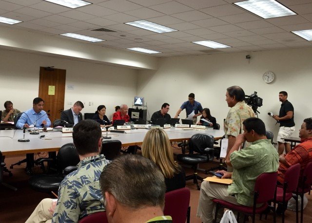 Hawaii Transportation Director Ford Fuchigami stands, at right, during a hearing before the House Transportation Committee, chaired by Rep. Henry Aquino, far left.