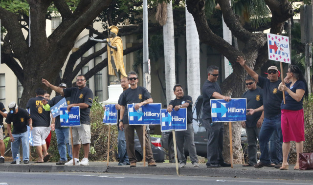 Hillary Clinton supporters wave to honking motorists along King Street. 23 march 2016.