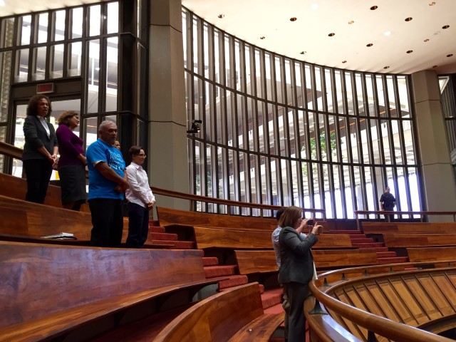 "Hawaiian Home Lands Deputy Director William Aila, left in blue shirt, stands while the House begins its floor session Tuesday with ""Hawaii Pono'i."""