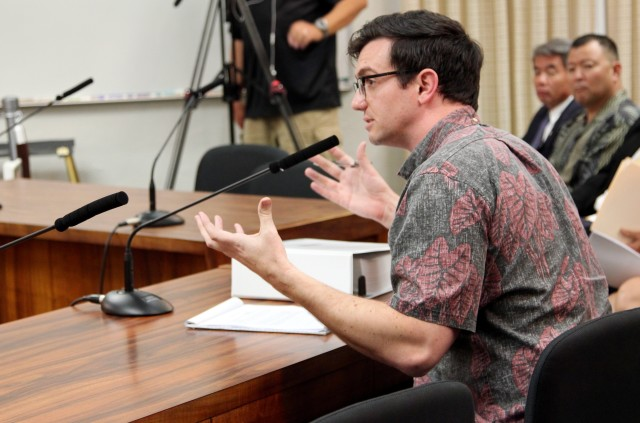 Uber Hawaii General Manager Brian Hughes speaks during a hearing on a bill to regulate transportation network companies like Uber and Lyft, Wednesday.