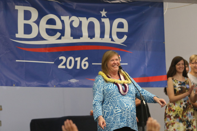 Jane Sanders speaks at her entrance at the Church of the Crossroads.