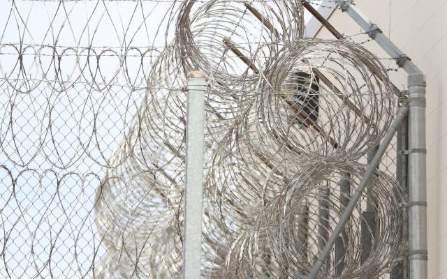 Saguaro Correctional Center CCA Fence CCA mountains Eloy Arizona Razor Wire3