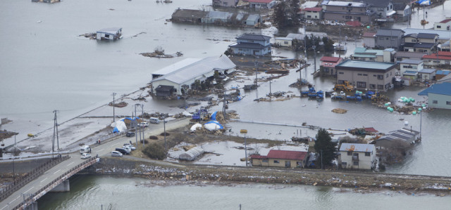 110318-M-HU778-007MINATO, Japan (March 18, 2011) An aerial view of Minato, Japan, a week after a 9.0 magnitude earthquake and subsequent tsunami devastated the area. (U.S. Marine Corps photo by Lance Cpl. Ethan Johnson/Released)