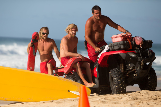 North shore lifeguards return from a rescue at Pipeline on Sunday.