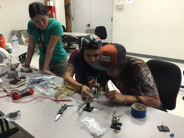 Three participants work on their project for the NASA Space Apps Challenge 2016, held for the first time in in Honolulu.