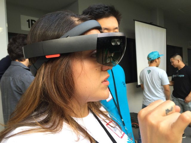 A participant at the NASA Space Apps Challenge in Honolulu looks through a virtual reality headset,
