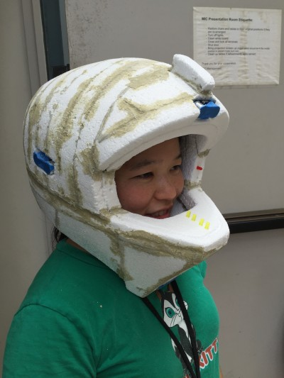 A participant at the Nasa Space Apps Challenge in Honolulu models a handcrafted helmet mockup.
