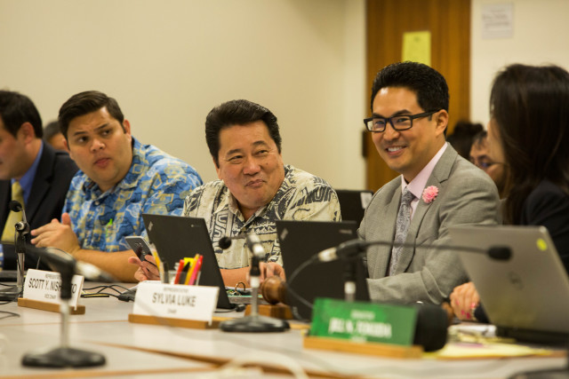 From right, Reps. Scott Nishimoto, Kyle Yamashita and Ty Cullen share a moment during the budget conference committee meeting. Cullen shepherded the grants-in-aid budget and Yamashita handled capital improvement projects for the House.