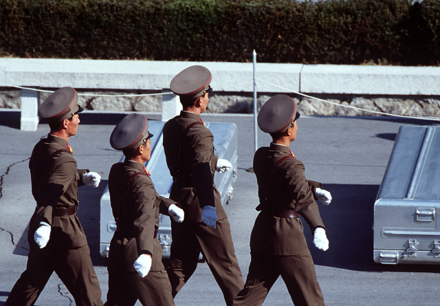 Korean People's Army Soldiers prepare to repatriate remains during a repatriation ceremony at the Panmunjom Joint Security Area on Nov. 6, 1998. Repatriation of Korean War remains are a result of a joint U.S./Democratic Peoples Republic of Korea joint recovery operation within North Korea to locate and return the U.S. service members to their homeland through Panmunjom. Twenty-nine service members have been returned since the joint recovery operation began in 1996. (U.S. Air Force photo by TSgt James Mossman) (Released)