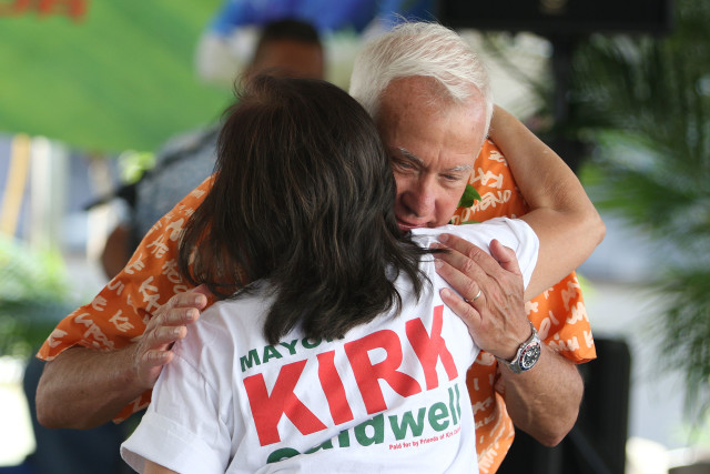 Mayor Kirk Caldwell hugs a supporter during kickoff of his campaign headquarters. 16 april 2016.