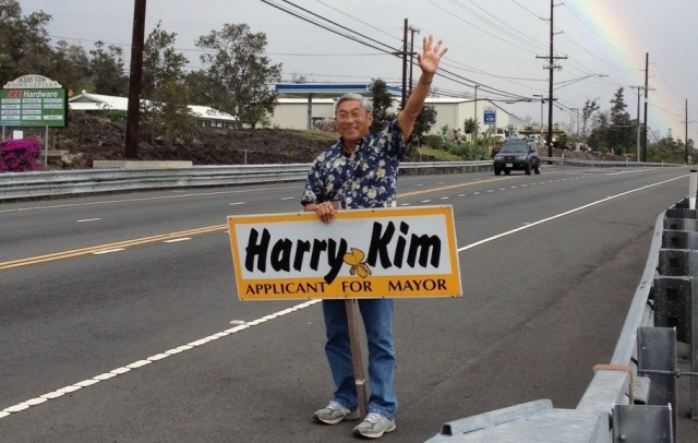 Kim waves with his one professionally produced sign during the 2012 campaign.