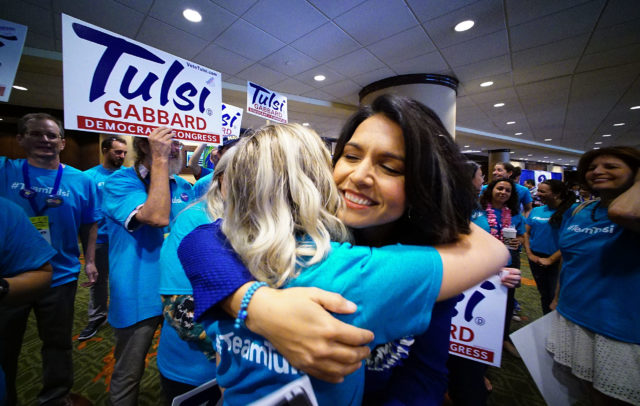 Congresswoman Tulsi Gabbard hugs supporter on the second day of the Hawaii State Democratic Convention held at the Sheraton Hotel. 29 may 2016.