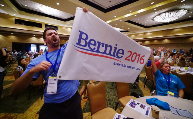 Bernie supporter Nathaniel Harmon fro District 2103 holds a large Bernie 2016 sign on the second day of the Hawaii State Democratic Convention held at the Sheraton Hotel. 29 may 2016. Chad possible hero or lede.