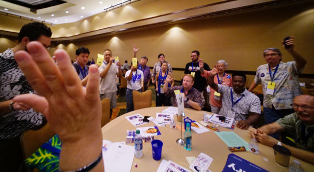 Hands rise during first round voting for female chair on the 2nd day of the Hawaii State Democratic Convention. Sheraton. 29 may 2016.