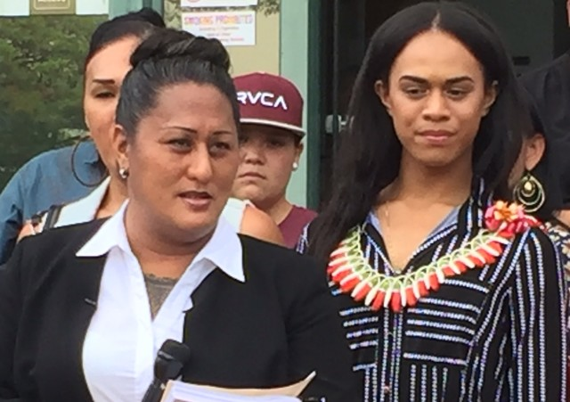 Transgender Native Hawaiian teacher Hina Wong-Kalu (left) and Jennea Purcell (right) at a protest at the Department of Education where they petitioned the Board of Education for greater protections for transgender students.