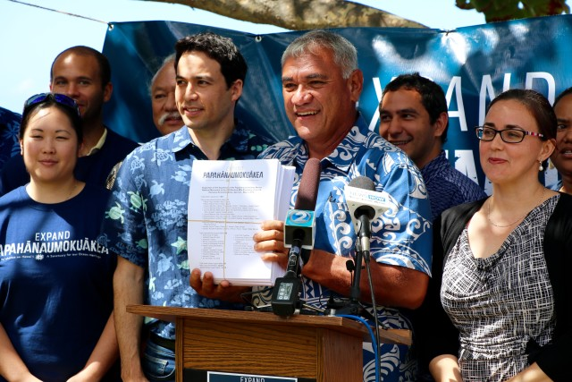 William Aila, flanked by Rep. Chris Lee and Sierra Club Director Marti Townsend, holds a petition supporting the expansion of Papahanaumokuakea Marine National Monument, Thursday, at Kewalo Marine Laboratory.