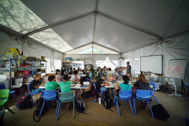 Middle school students enjoy a lesson at the SEEQS Charter school in Kaimuki. 4 may 2016.
