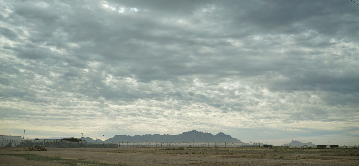 Saguaro Correctional Facility Eloy Arizona clouds and mountain range. 6 march 2016. photograph Cory Lum/Civil beat