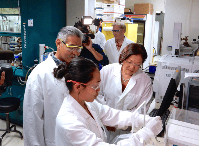 Sen. Mazxie Hirono and Gov. David Ige at Hawaii Biotech, where researchers are working to develop a Zika virus vaccine.