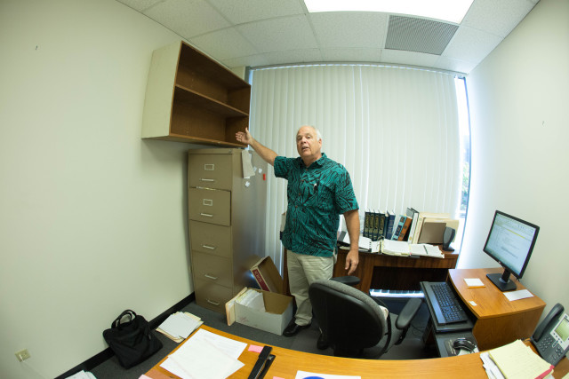 Honolulu Ethics Commission Executive Director Chuck Totto points out that a shelf in his office no longer holds any of his personal belongings.