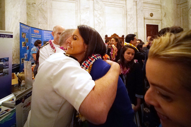 Congresswoman Tulsi Gabbard hugs some naval personnel at booth the Kennedy Caucus, Russell Senate Office building in the 3rd Annual Hawaii on the Hill. 8 june 2016