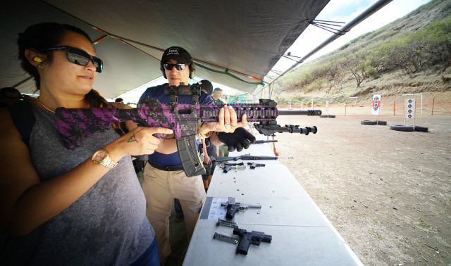 Tiffany Akai fires a M&P15-22 22 caliber rifle during Hawaii Rifle Association's 23rd Annual Shooting Sports Fair held at the Koko Head Shooting Complex. 19 june 2016