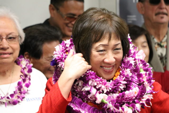 Colleen Hanabusa adjusts her lei after filing to run for Congress on June 2 the Hawaii Elections Office.