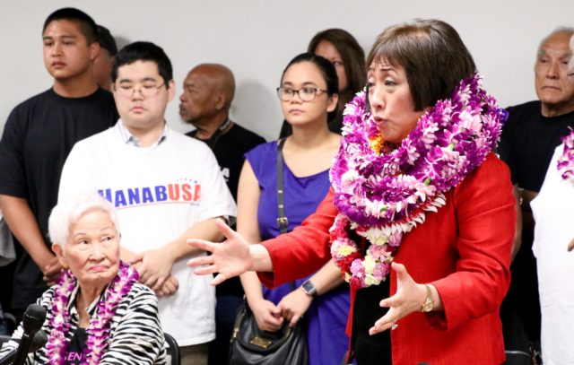 Colleen Hanabusa addresses reporters and supporters after officially filing to run for Congress, Thursday, at the state elections office.