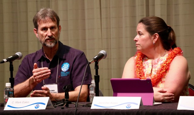 NOAA's Mark Eakin, left, and Jennifer Koss, along with Billy Causey (not pictured), discussed the largest, most widespread coral bleaching event during the International Coral Reef Symposium, Monday at the Hawaii Convention Center.