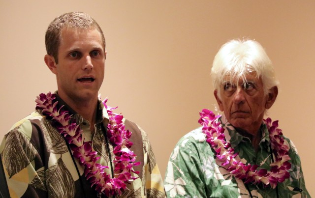 Duke Hartman, left, of Makai Ocean Engineering, discusses ocean thermal energy conversion as Luis Vega, manager of the Hawaii National Marine Renewable Energy Center, listens.