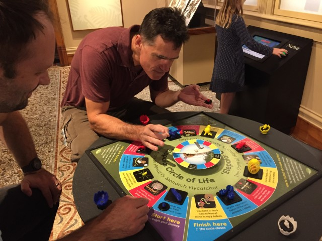 "The Bishop Museum's digital developer, Nicholas Griffith and its exhibit designer, Michael Wilson, show the ""Elepaio: Circle of Life"" board game."