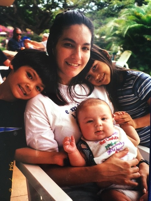 Fresh from jail, Georgianna DeCosta is shown with her three children at the Salvation Army Women's Way rehabilitation center in Honolulu.