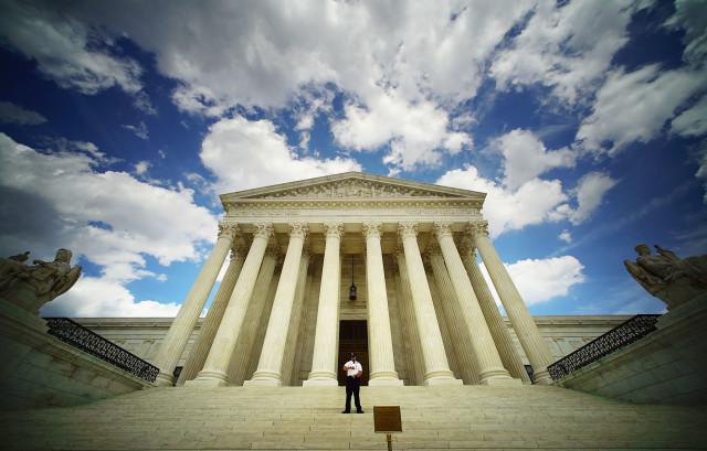 Supreme Court Building Washington DC clouds. 6 june 2016.