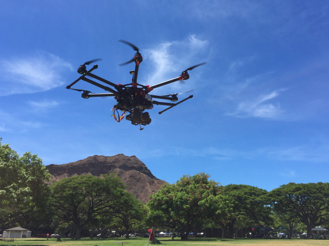 A drone hovers over the 2015 Geek Meet at Kapiolani Park.