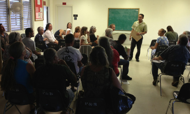 Councilman Greggor Ilagan speaks during a community meeting in the district.