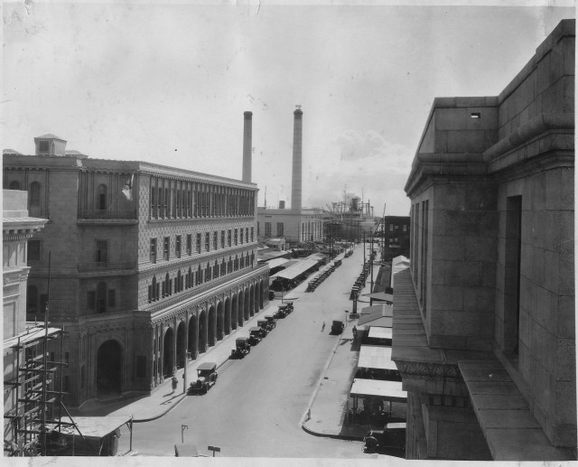 Electricity really began to catch on in Honolulu in the 1920s. Hawaiian Electric's waterfront power plant looms in the background of Bishop Street.