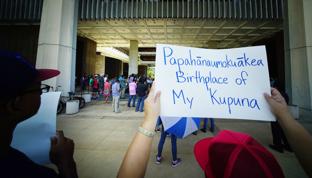 An Expand Papahanaummokuakea supporter holds a sign during Fishing Means Food rally held in the Capitol Rotunda. 26 july 2016