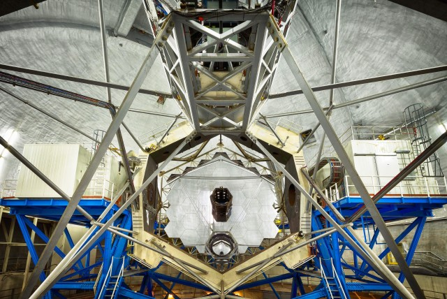 A wide angle view of the ten-meter Keck Observatory mirror. The observatory was one of four telescopes atop Mauna Kea used to identify 104 new exoplanets.