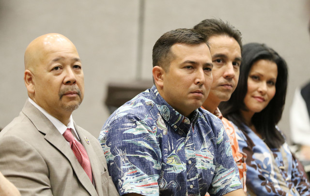 City Council members Chair Ernie Martin, Council members Trevor Ozawa, Joey Manahan and Kymberly Pine watch as Mayor Caldwell, Peter Carlisle and Charles Djou slug it out during debate held at Blaisdell Exhibition hall. 14 july 2016