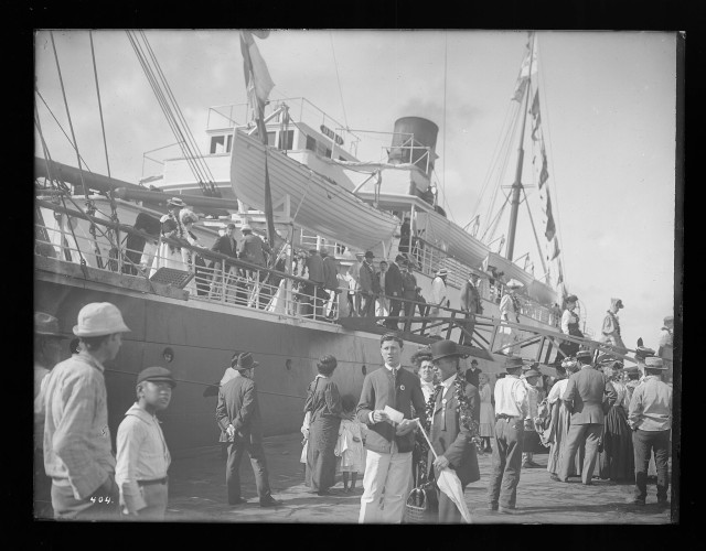 The steamship Ohio brought visitors to Hawaii as tourism picked up in the early 1900s. Here, passengers disembark from the ship in Honolulu Harbor, circa 1900-1907.