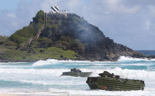US Marines Amphibious Assault Vehicle rolls onto the sands at Pyramid Rock, Marine Corps Base Hawaii. Kaneohe Hawaii. 30 july 2016