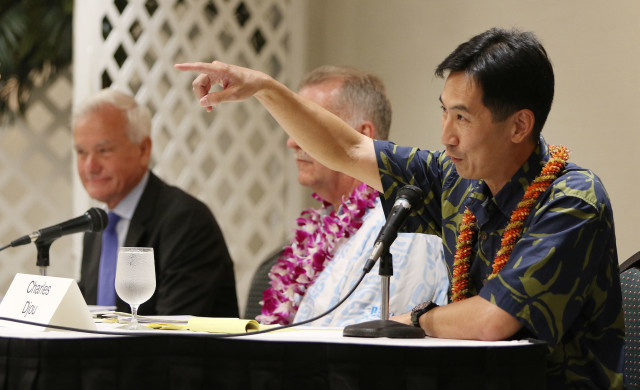 Mayoral candidate Charles Djou introduces himself and points to back of the banquet hall introducing his wife before Rotary Club mayoral forum held at the Japanese Culture Center of Hawaii. 26 july 2016