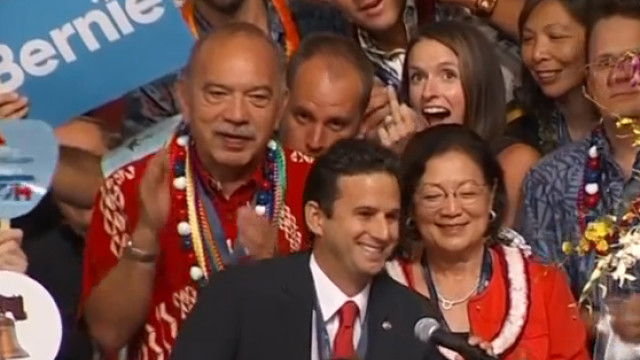 As national television broadcast the Democratic National Convention presidential nomination roll call, Hawaii delegate Chelsea Lyons Kent gives the middle finger. The gesture infuriated many in Hawaii, but made her a hero to some diehard Bernie Sanders supporters.