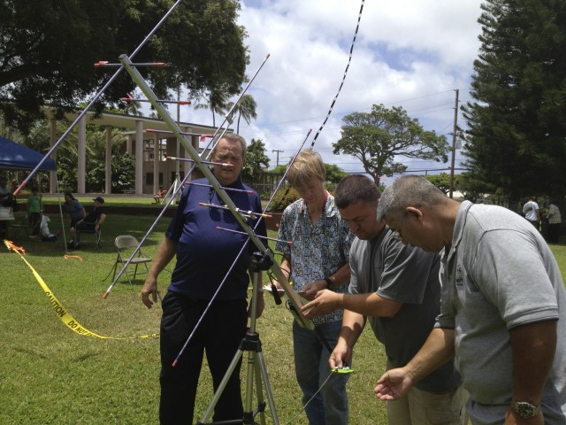 Local amateur radio operators set up an antenna at the University of Hawaii at Manoa for a 'field day' demonstration.