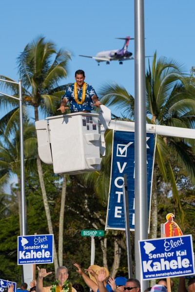 Kai Kahele campaigns as a Hawaiian Airlines plane flies overhead. The pilot says his experiences around the world provide ideas to pursue in office.