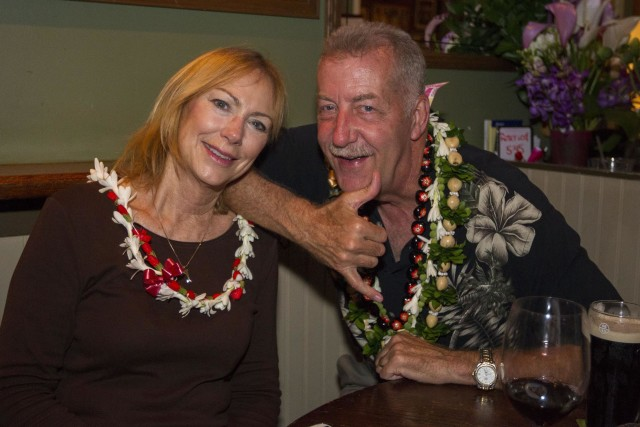 Honolulu mayoral candidate Peter Carlisle, right, enjoys the evening with his wife Judy Carlisle, left, at J.J. Dolan's after conceding the Honolulu mayor's race Saturday, Aug. 13, 2016, in Honolulu. Photo by Eugene Tanner